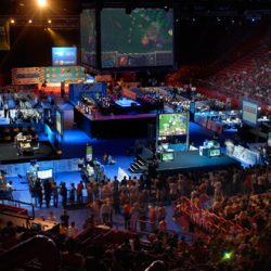 wide shot of gaming arena filled with gamers and people