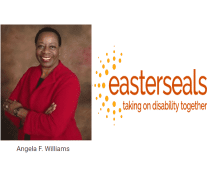 Angela Williams of Easterseals poses in red dress for camera