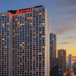 Picture of the Marriott Hotel on Chicago's Magnificent Mile with a sunset background and other tall buildings