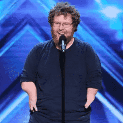 Ryan Niemiller standing on stage in front of audience at America's Got Talent