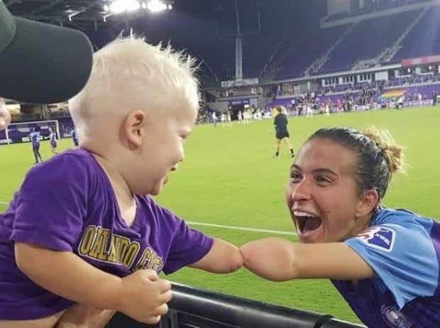 boy born with no hand meets soccer player with same