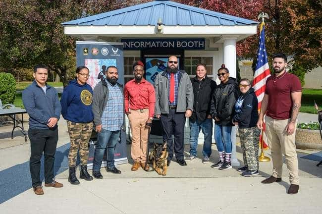 K-9 Keen and Jason Pryor stand outside in a group photos with student body members