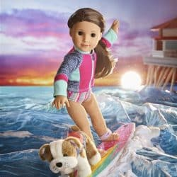 American Girl Doll Joss Kendrick wearing hearing aid and surfing with her dog on the surfboard