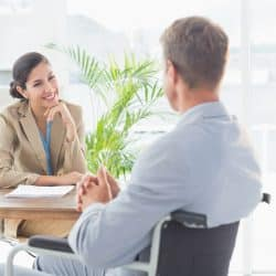 man in wheelchair talking with hiring manager