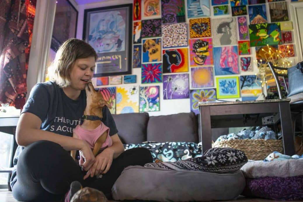 Jess Faerman at home in her apartment with her dog
